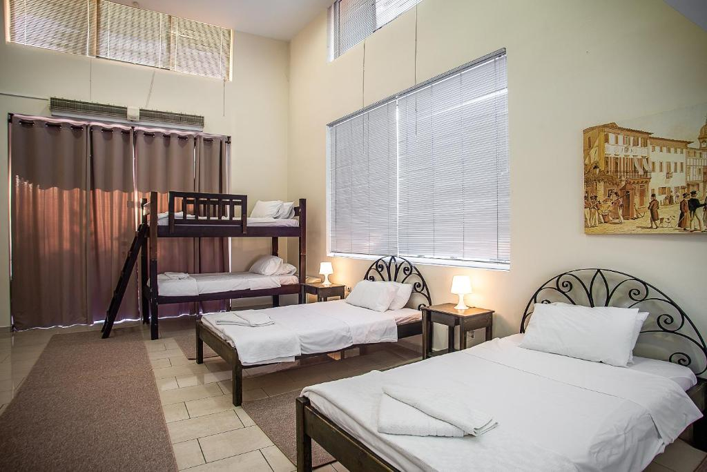 A bed or beds in a room at Urban Living City Hostel/ Private Rooms