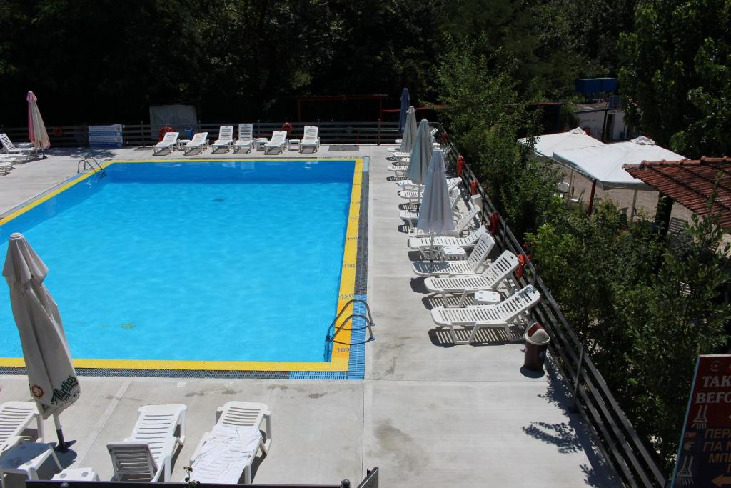 A view of the pool at Boufidis Rooms or nearby