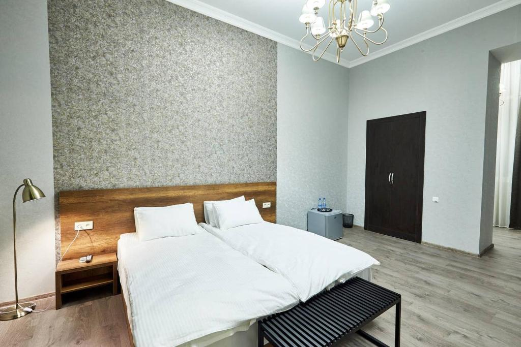 Posteľ alebo postele v izbe v ubytovaní 2nd Floor Tbilisi