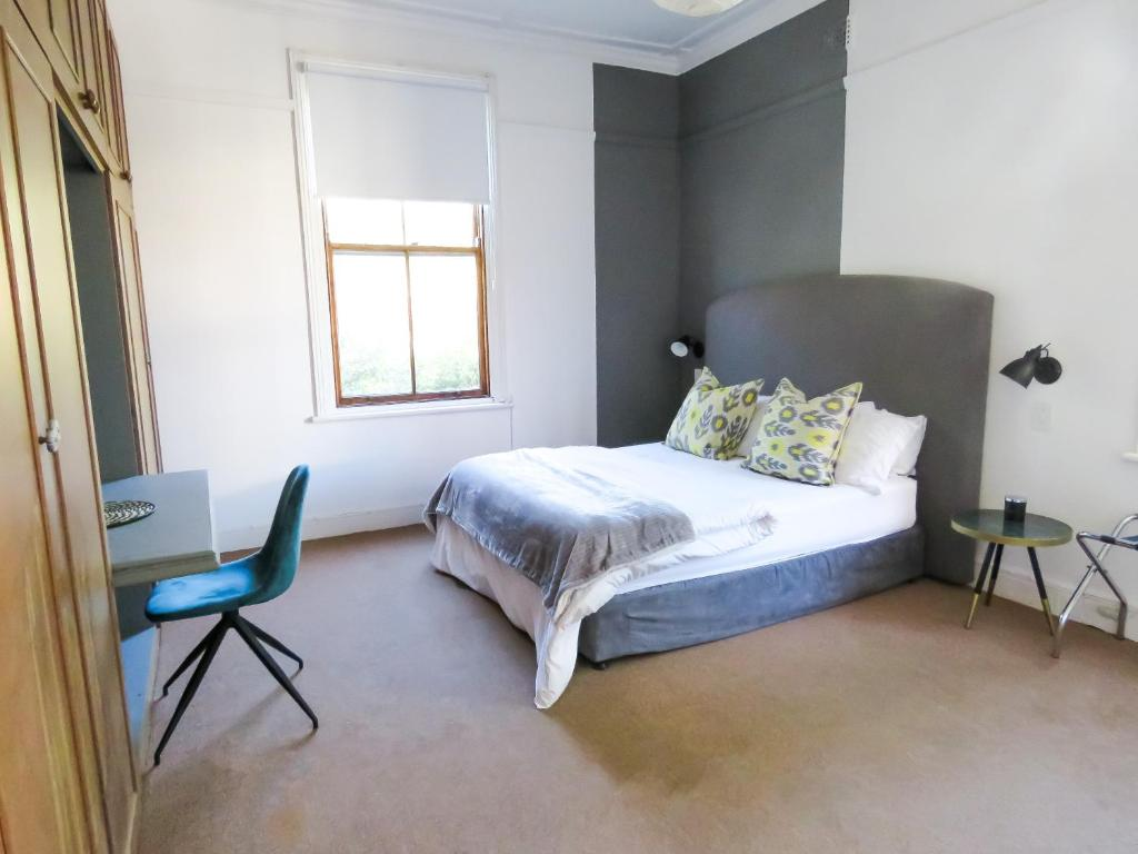 A bed or beds in a room at The Rosemore Guesthouse