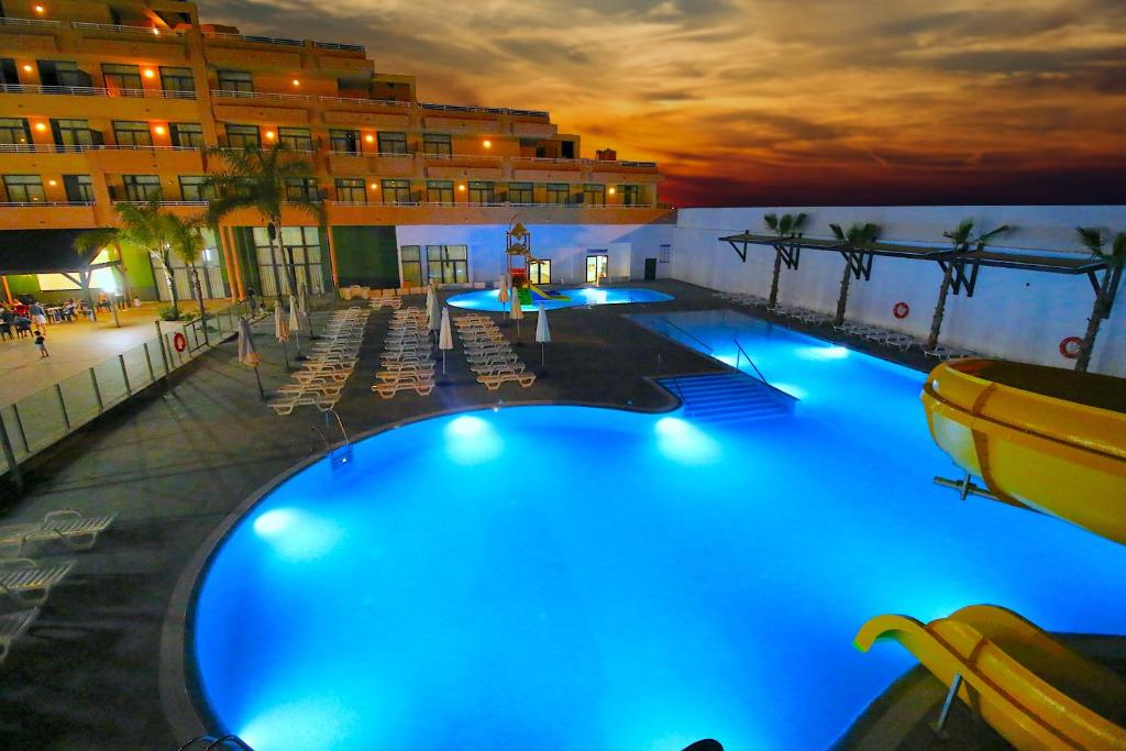 The swimming pool at or near Advise Hotels Reina