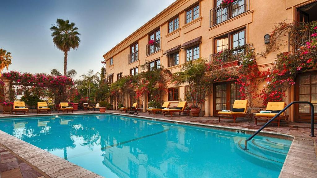 The swimming pool at or near Best Western Plus Sunset Plaza Hotel