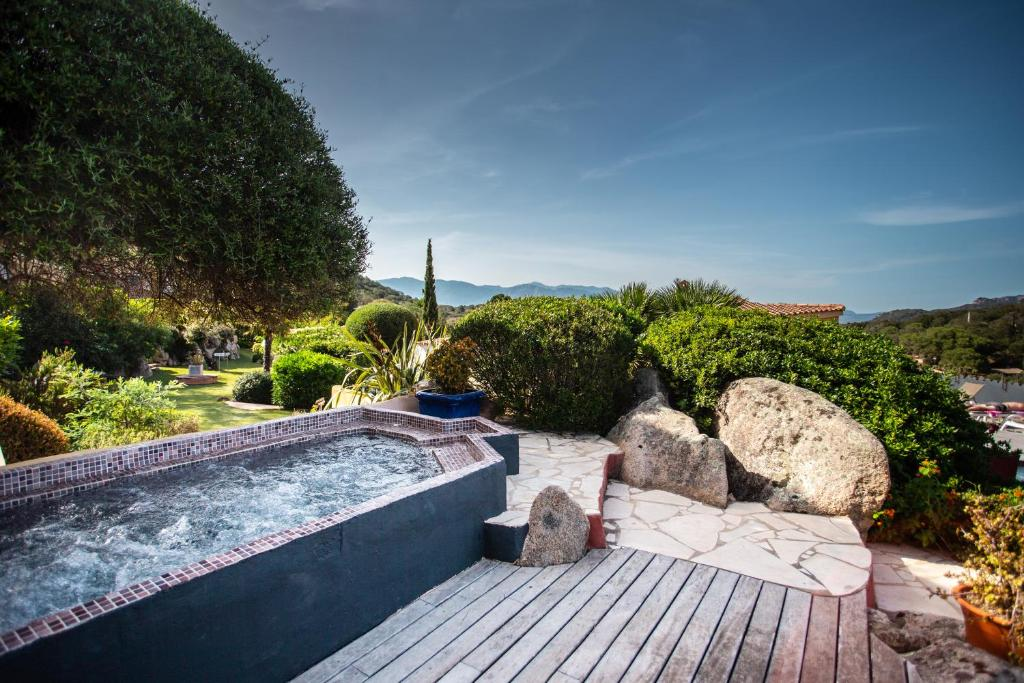 The swimming pool at or near Le Roc E Fiori Hotel - Les Collectionneurs