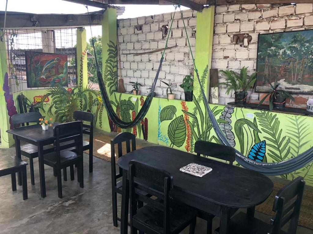 A restaurant or other place to eat at Green Track Hostel