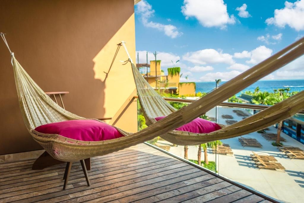 A balcony or terrace at Hotel Xcaret Mexico - All Parks & Tours / All Inclusive