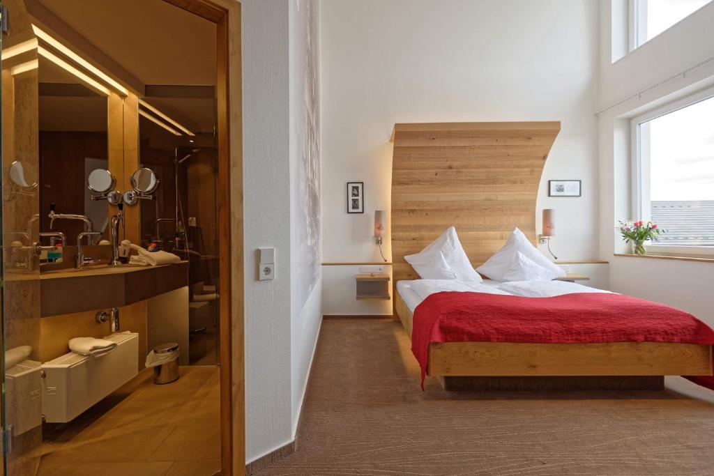 Llit o llits en una habitació de Hotel zur Malzmühle