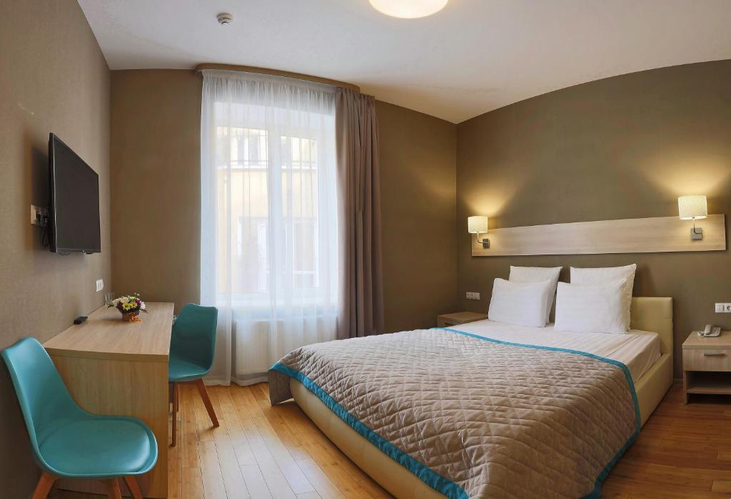 Кровать или кровати в номере U Hotel