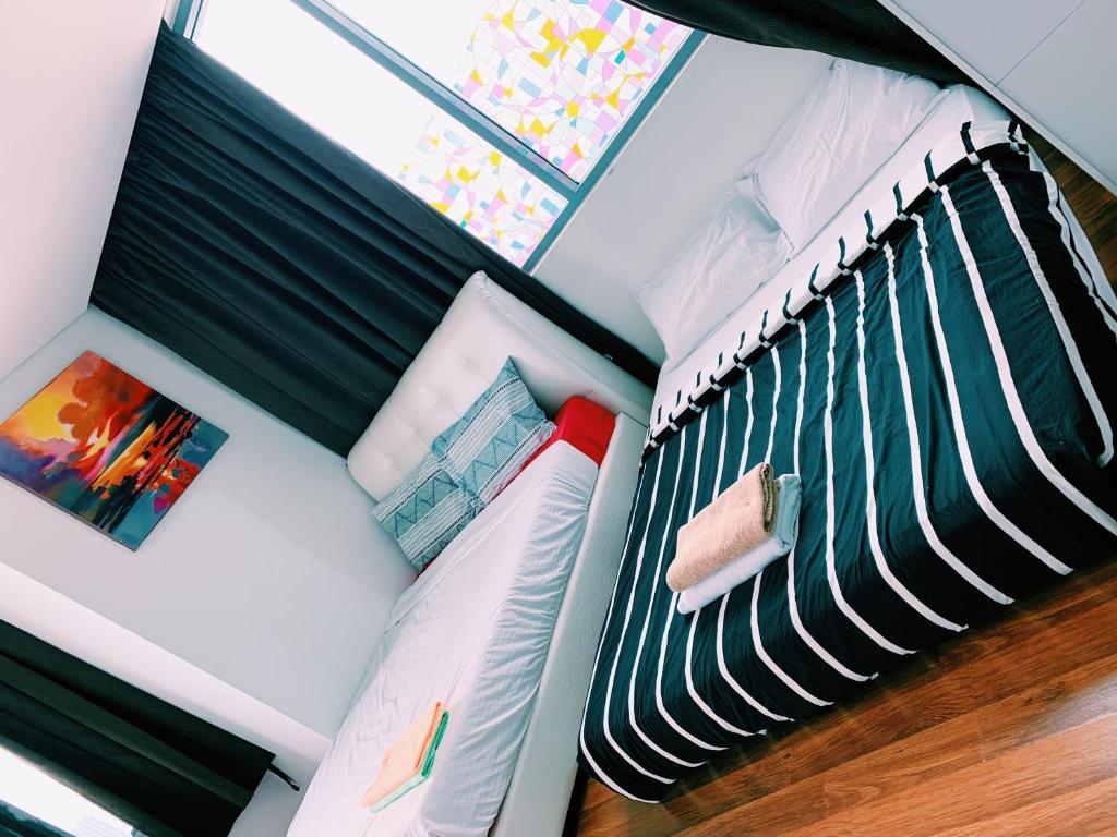 Mercu Summer Suite @ Edrea Homes 객실 침대