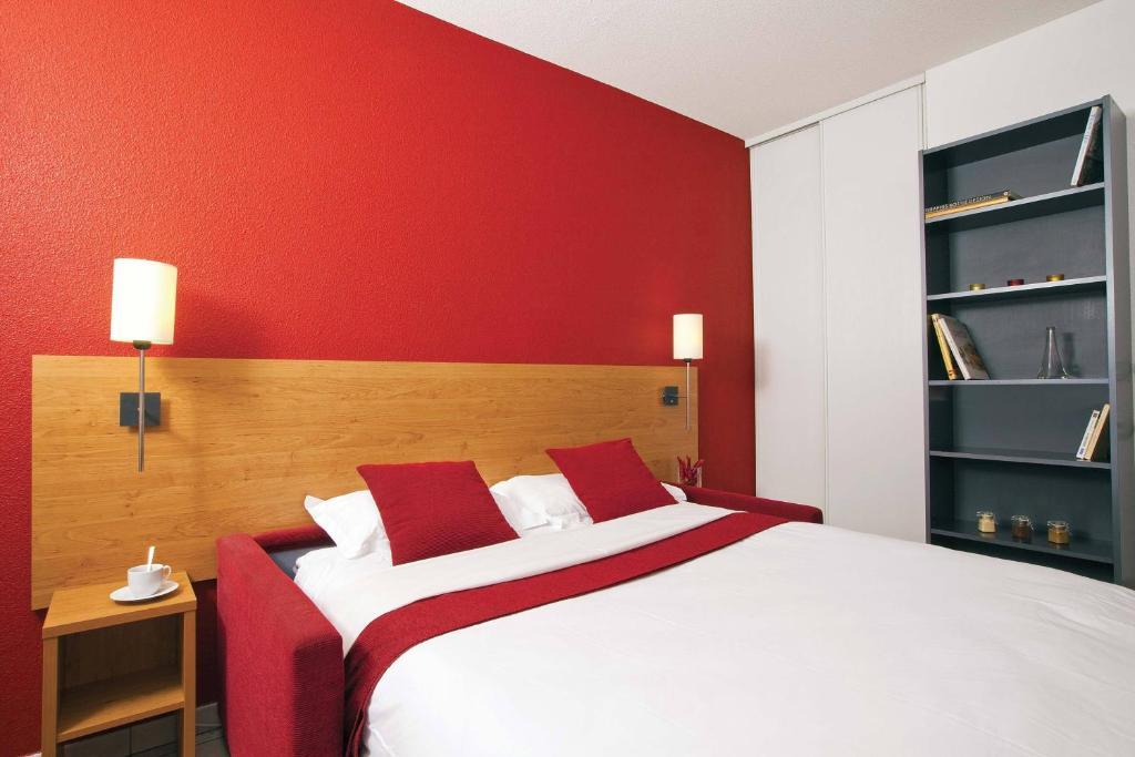 Un ou plusieurs lits dans un hébergement de l'établissement Séjours & Affaires Lyon Park Lane