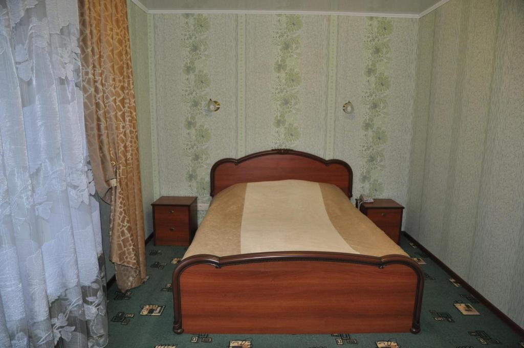 Кровать или кровати в номере Отель Уют
