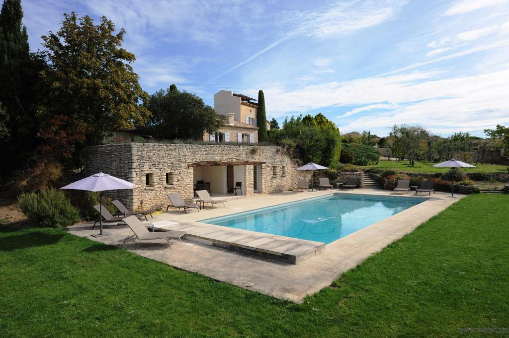 The swimming pool at or near Domaine de l'Enclos