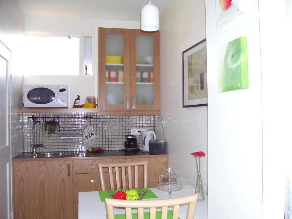 A kitchen or kitchenette at Comfort 4U In Keflavik