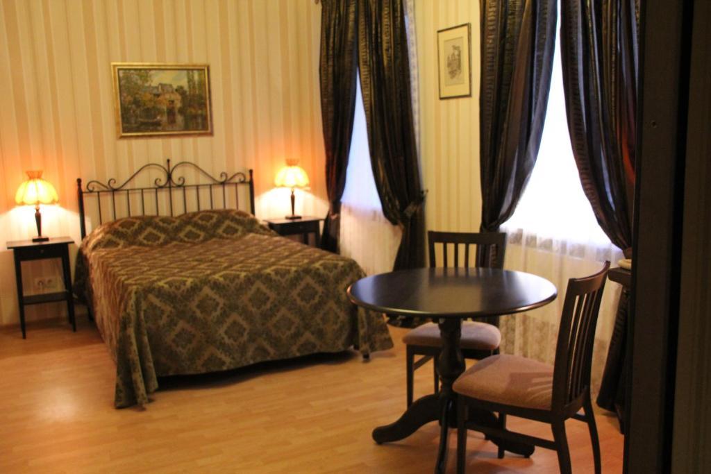 Кровать или кровати в номере Abrikos Hotel