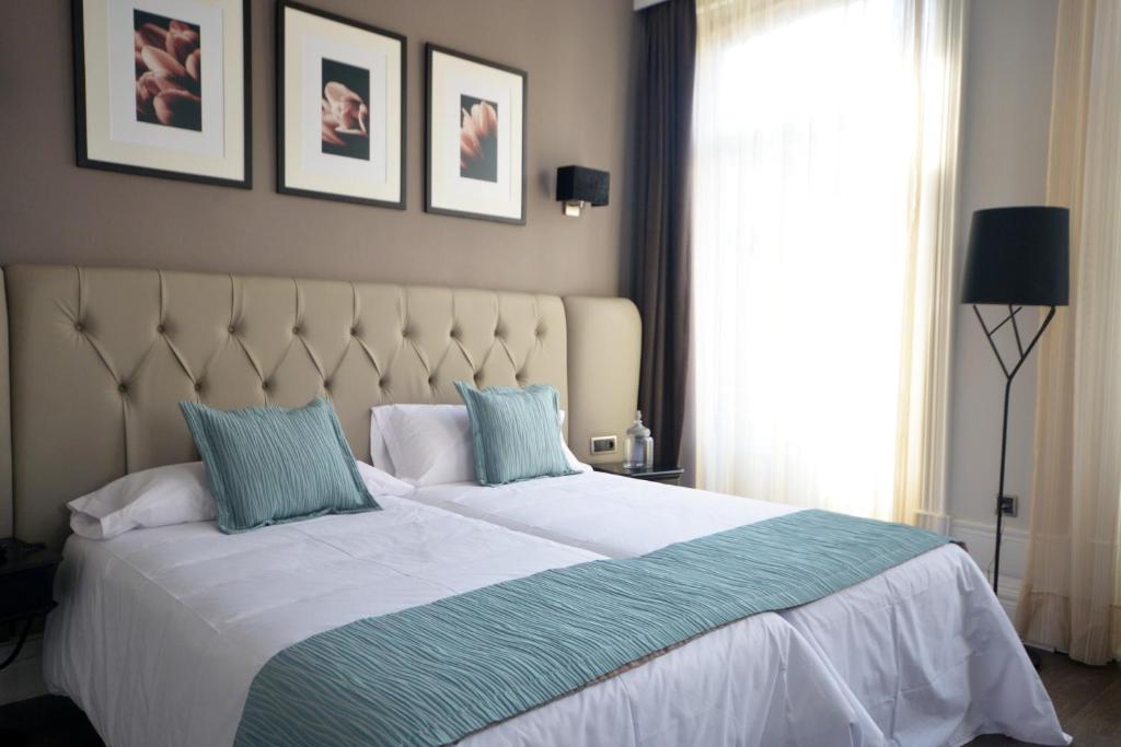 Een bed of bedden in een kamer bij Hotel Bienestar Termas De Vizela