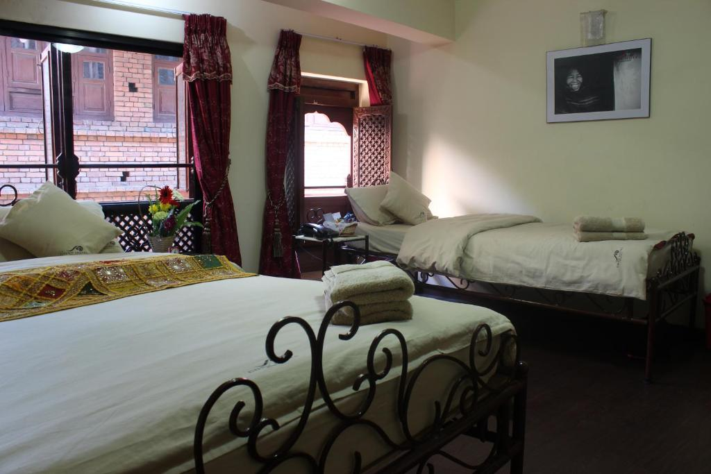 A bed or beds in a room at Cosy Hotel