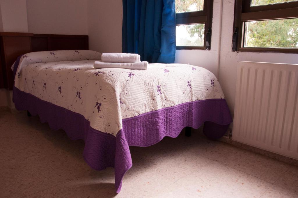 Cama o camas de una habitación en Hospedería Reina De Los Ángeles