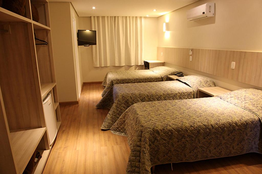 A bed or beds in a room at Golden Hotel