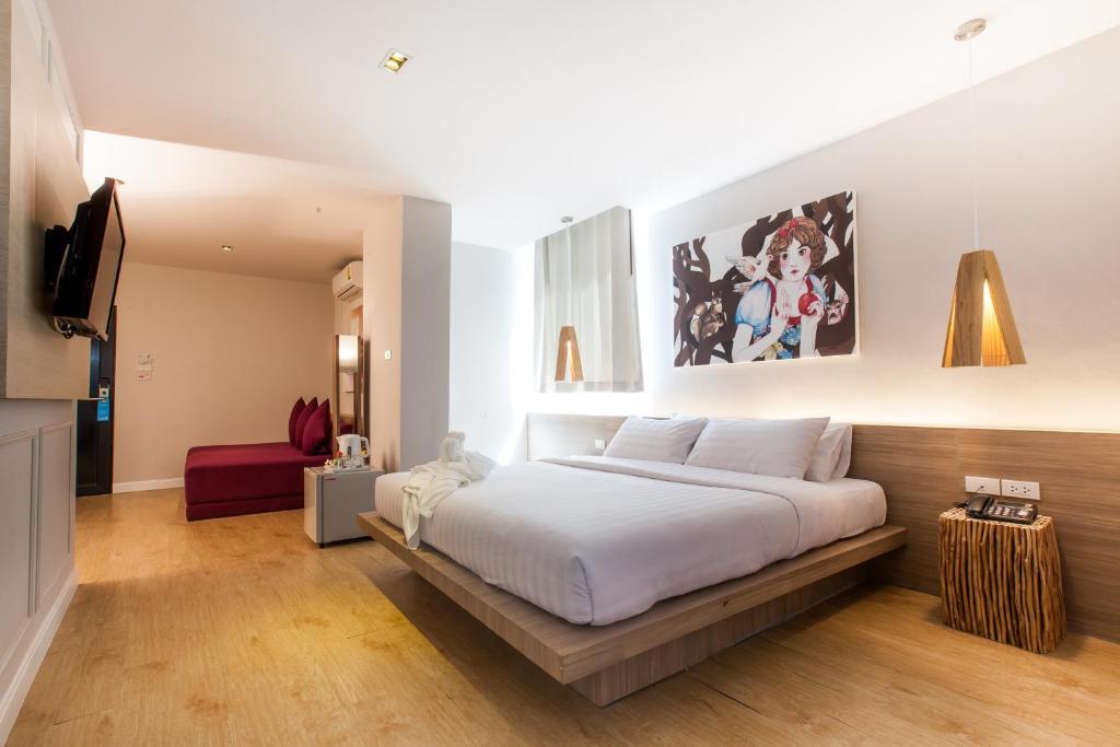 Voodi või voodid majutusasutuse THE BED Hatyai toas