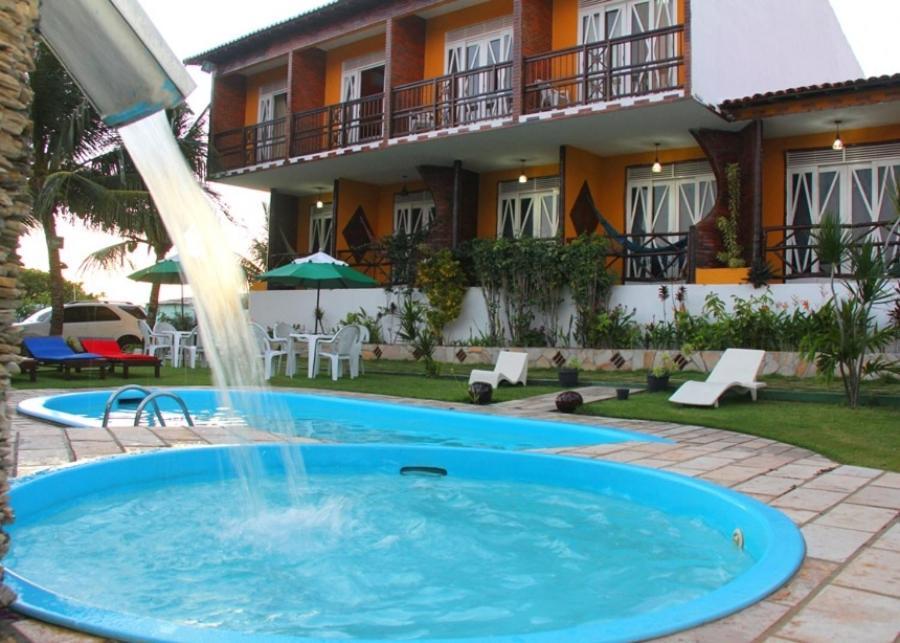 The swimming pool at or near Pousada Gitana