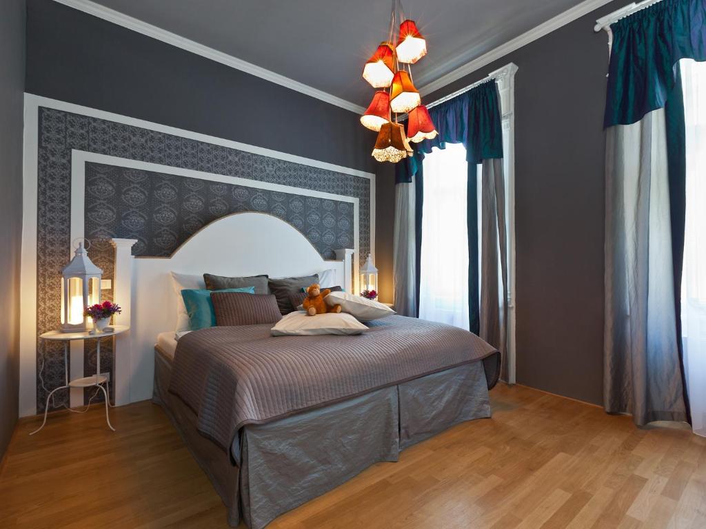 Łóżko lub łóżka w pokoju w obiekcie Royal Prague City Apartments