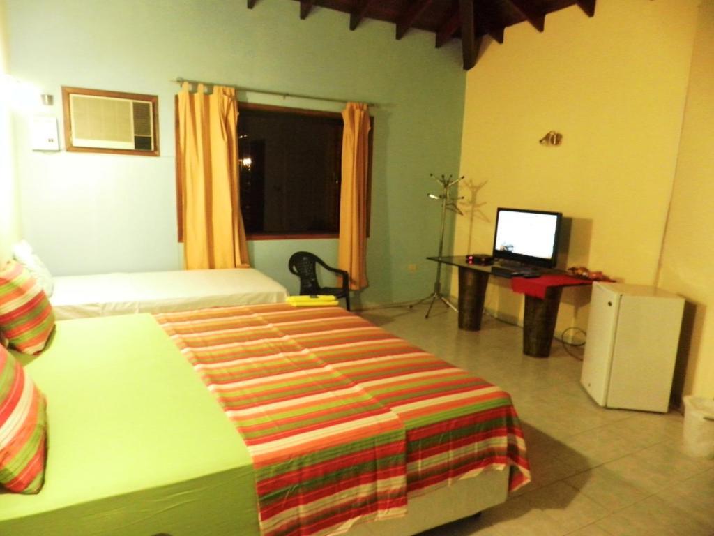 Ein Bett oder Betten in einem Zimmer der Unterkunft Hotel Las Residentas