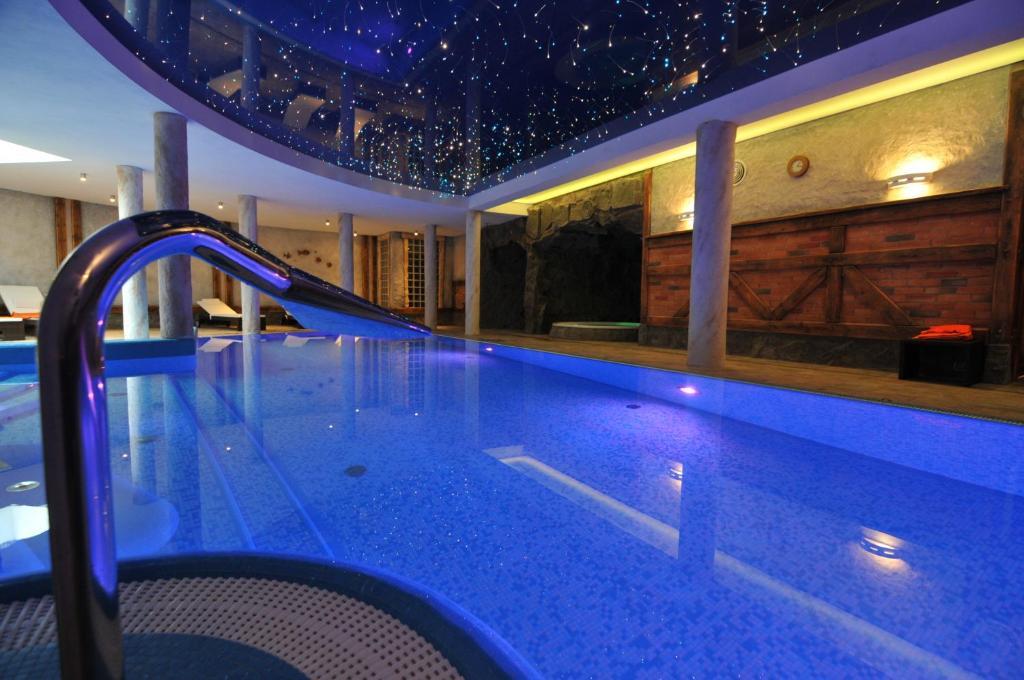 The swimming pool at or near Hotel Kryształ Conference & Spa