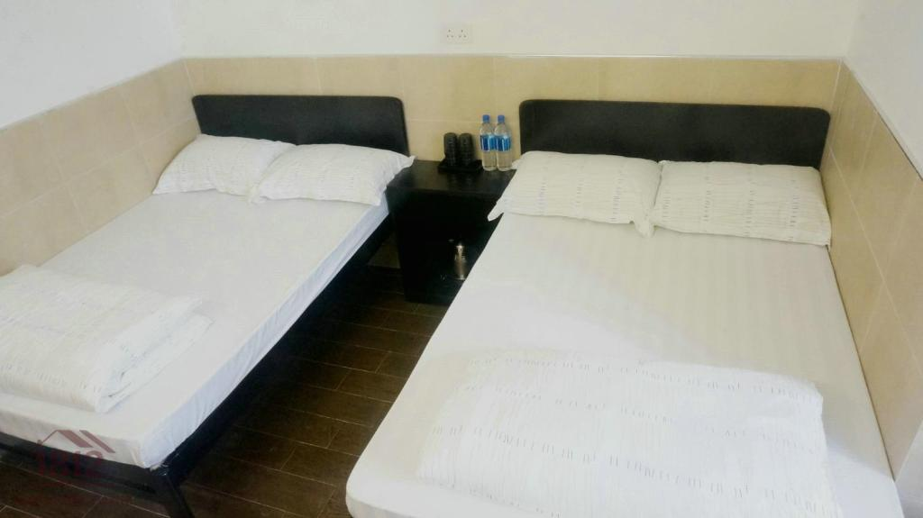 A bed or beds in a room at Kowloon Mongkok 1812 Guest House