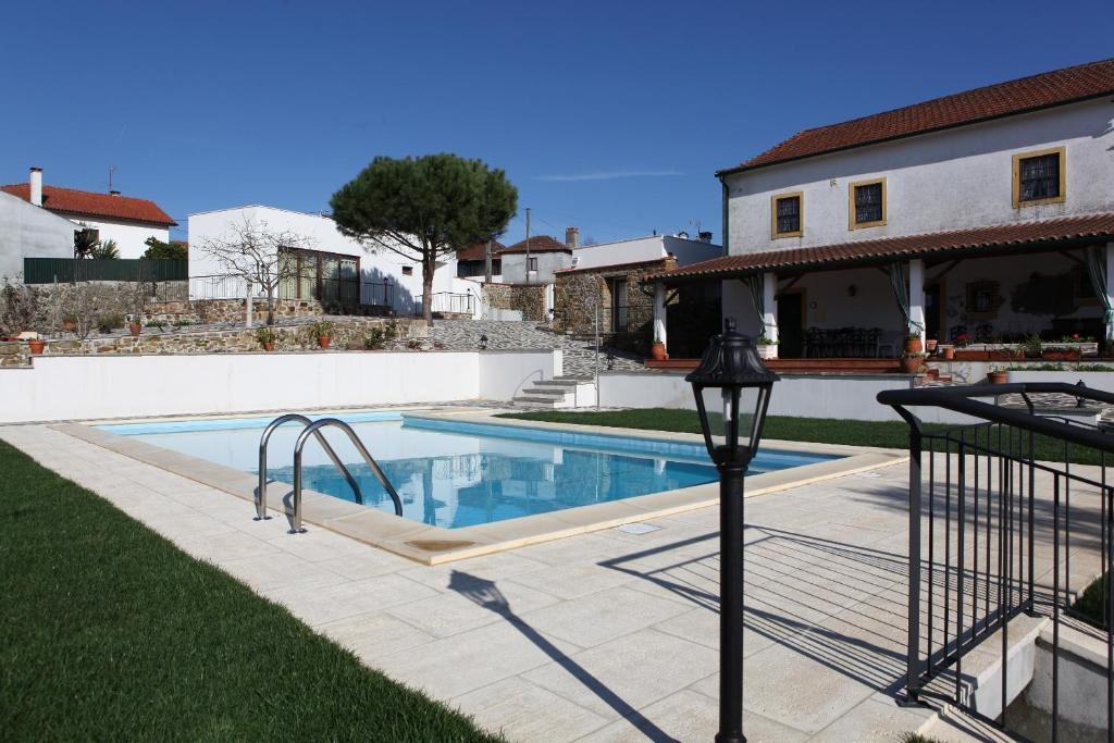 The swimming pool at or near Casa de Santo Antonio