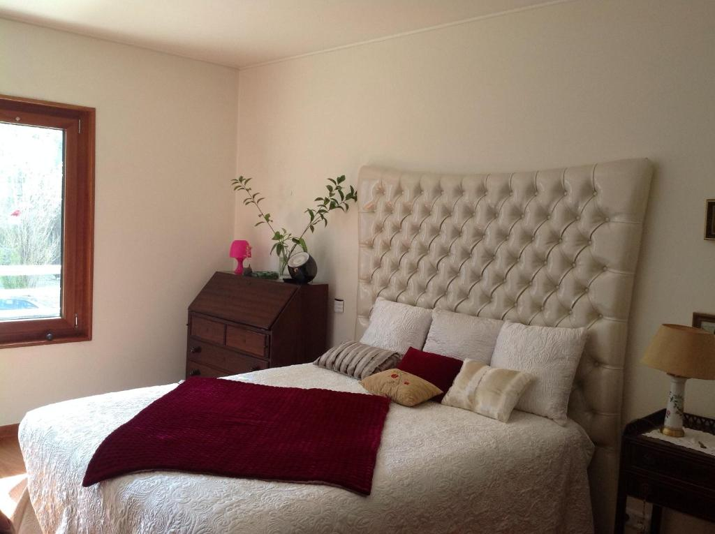 A bed or beds in a room at Canas Guest House in Lisbon (AL)