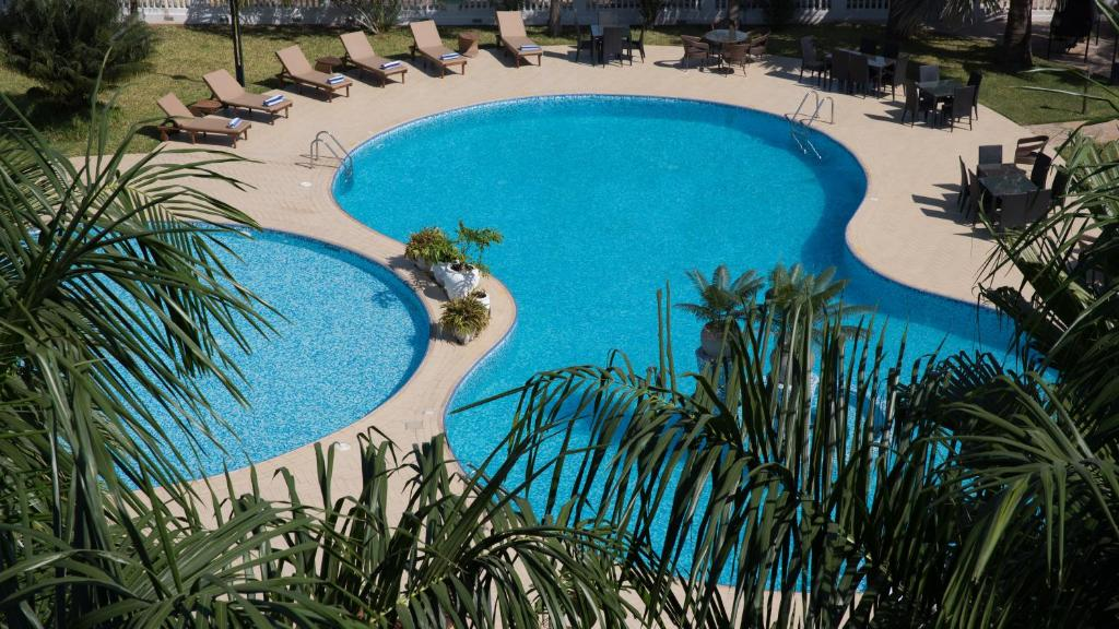 A view of the pool at DoubleTree by Hilton Dar es Salaam Oysterbay or nearby