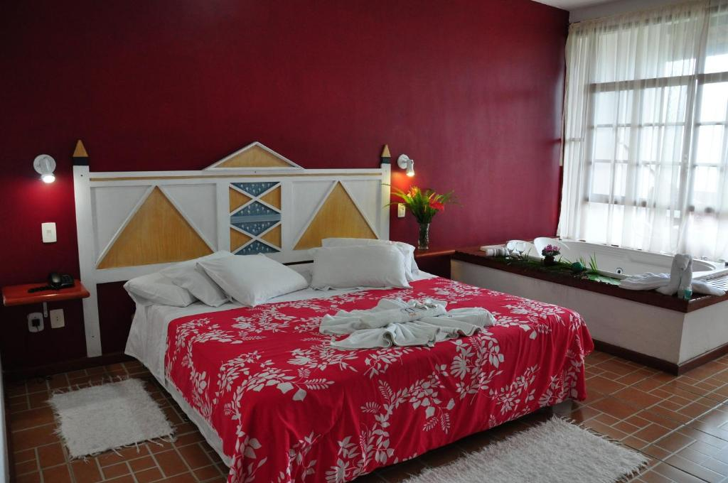 A bed or beds in a room at Pousada e Spa Vrindávana