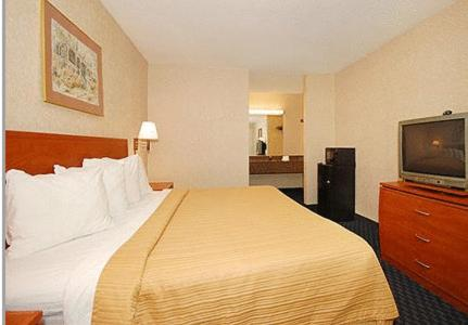 A bed or beds in a room at Greenville Inn & Suites