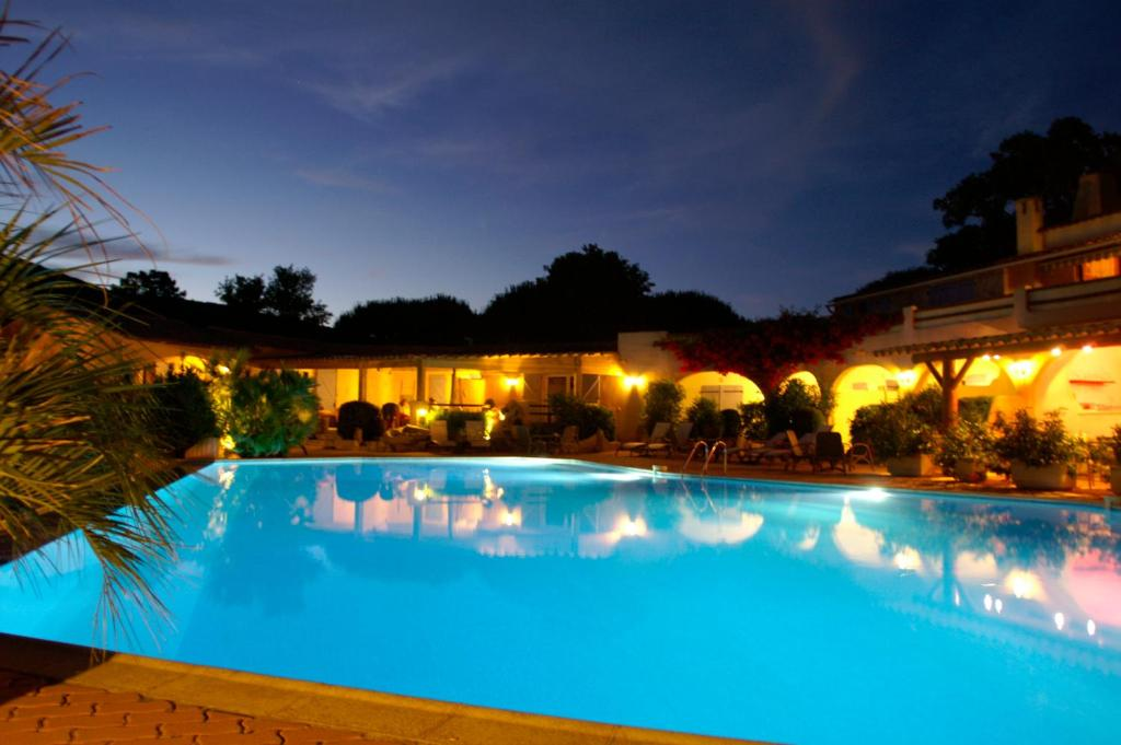 The swimming pool at or near Hôtel Palombaggia