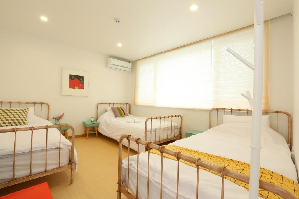 A bed or beds in a room at PandaGo Guesthouse - Female Only