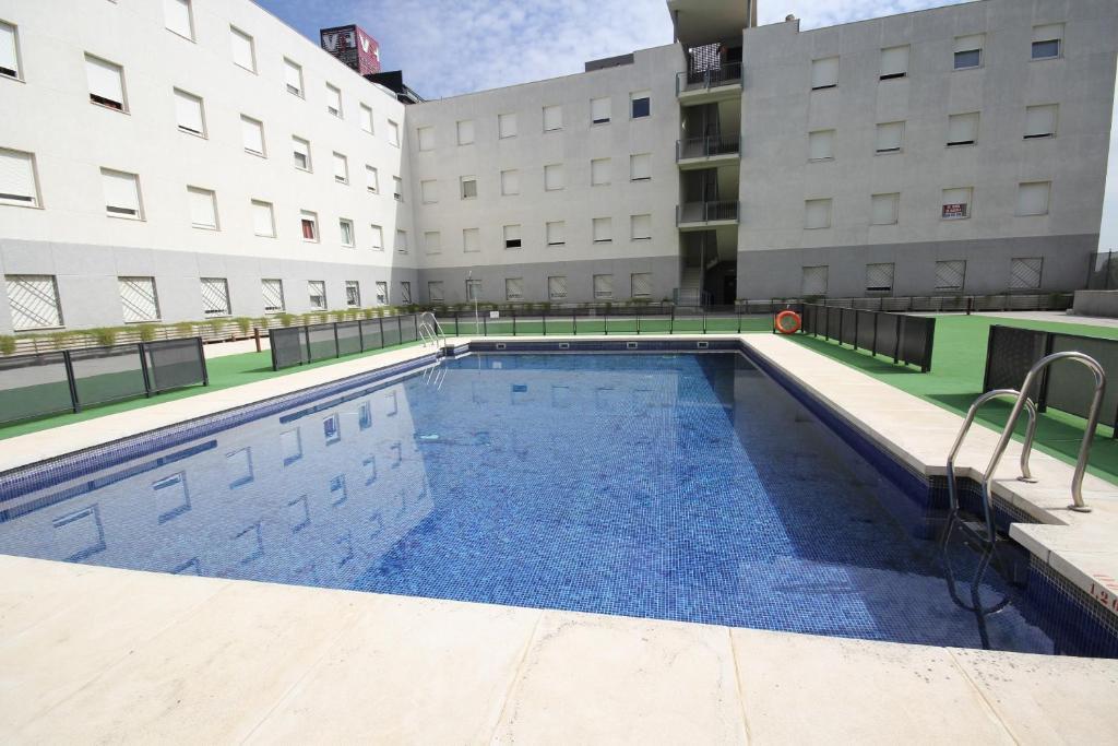 The swimming pool at or close to Apartamentos Vértice Sevilla Aljarafe