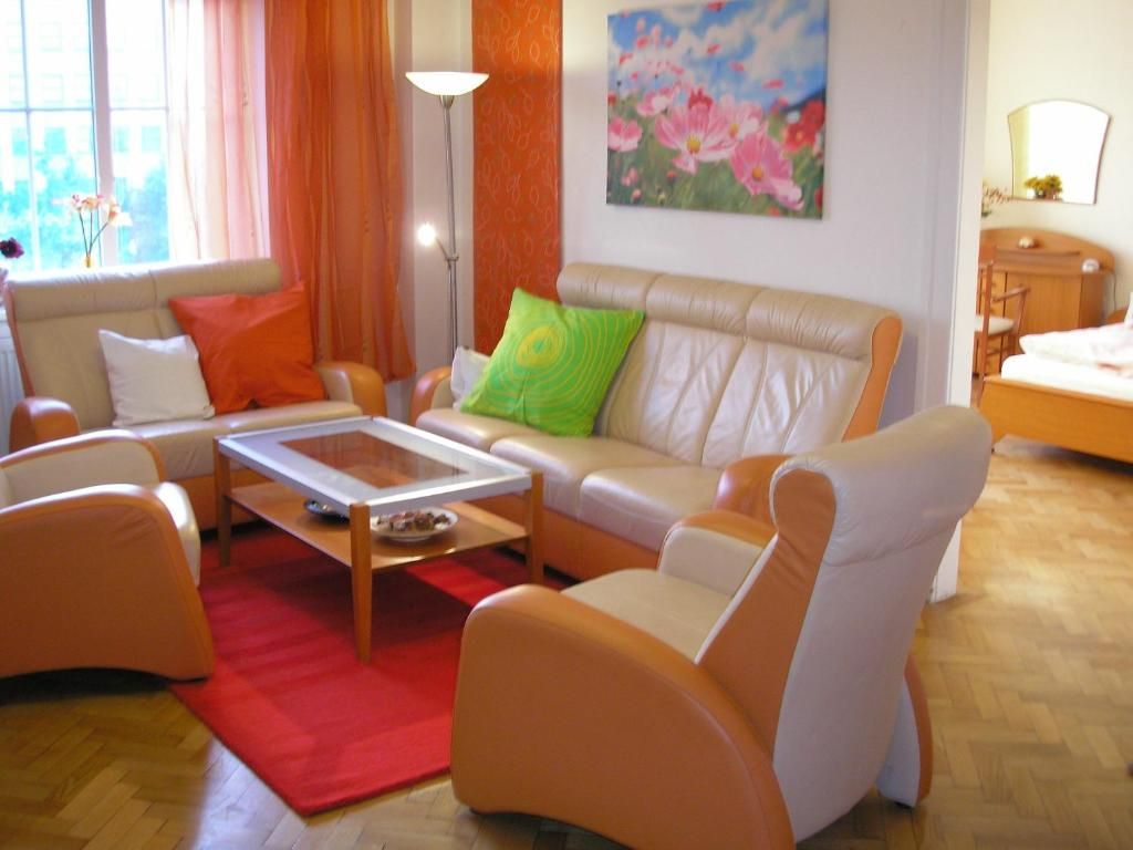 A seating area at Holiday Apartment up to 7