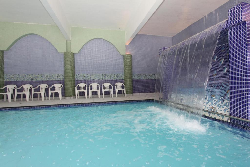 The swimming pool at or near Hotel Fredy