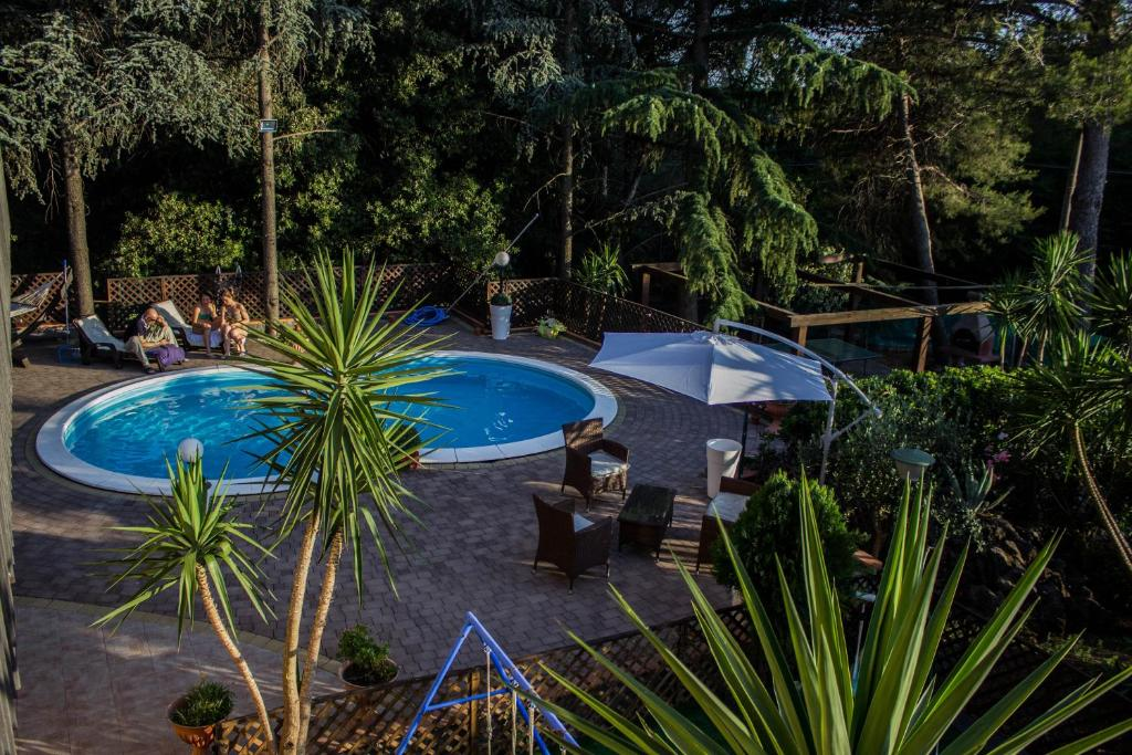 A view of the pool at B&B Etna House or nearby