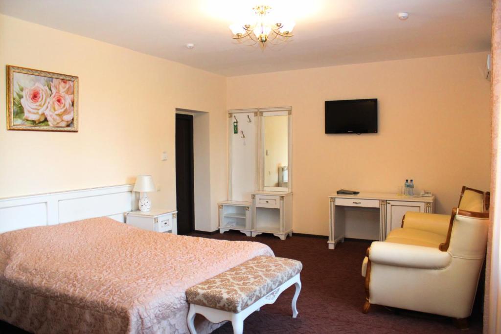 Кровать или кровати в номере Гостиница Украина