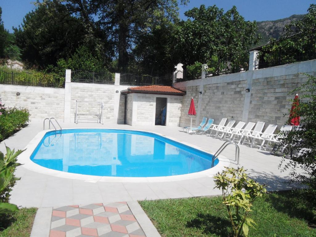 The swimming pool at or near Apartments Maini