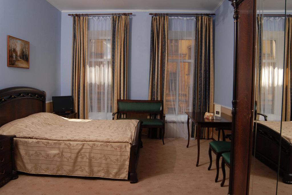 Кровать или кровати в номере Мини-отель MK Классик