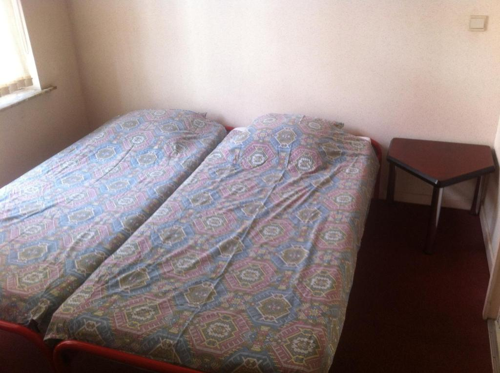 A bed or beds in a room at Flat Brussels center
