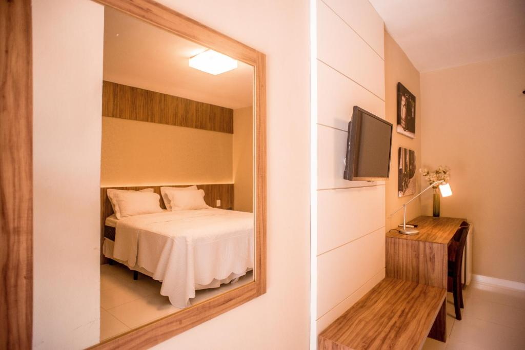 A bed or beds in a room at Hotel Parque do Sol