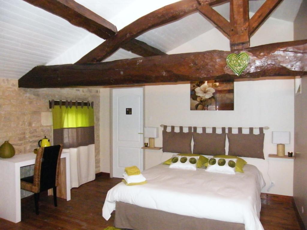 Uma cama ou camas num quarto em B&B L'escapade