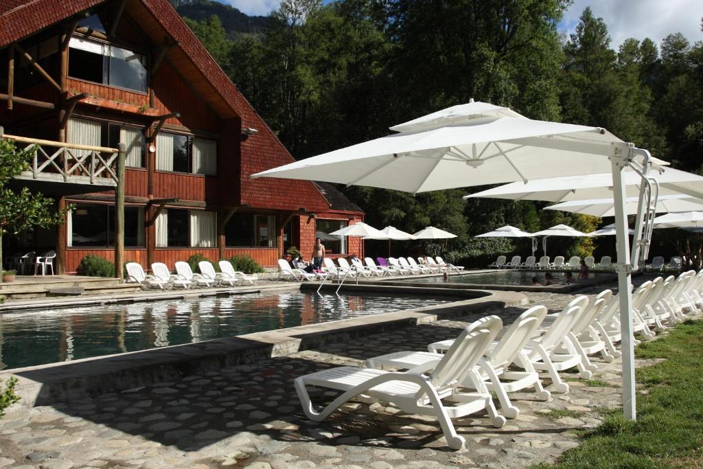 The swimming pool at or near Hotel y Termas Huife