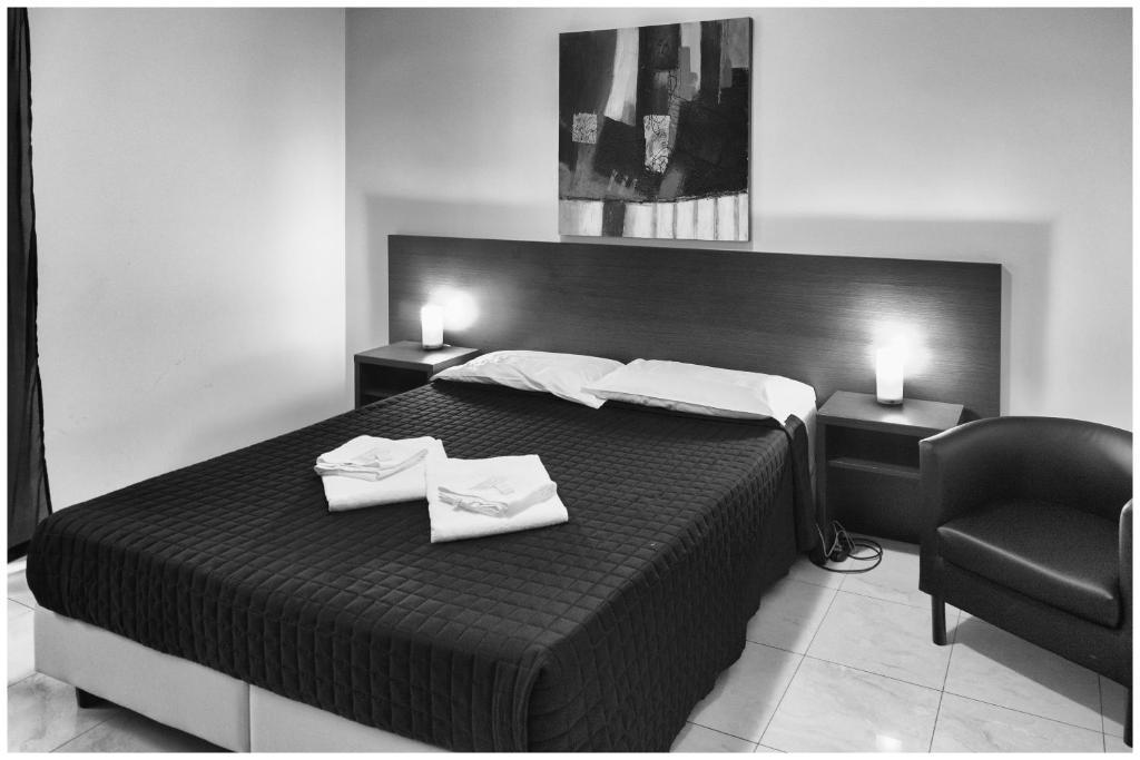 Кровать или кровати в номере Hostel Mosaic
