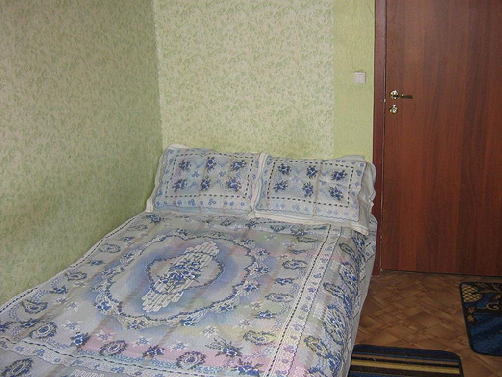 A bed or beds in a room at Family Stay