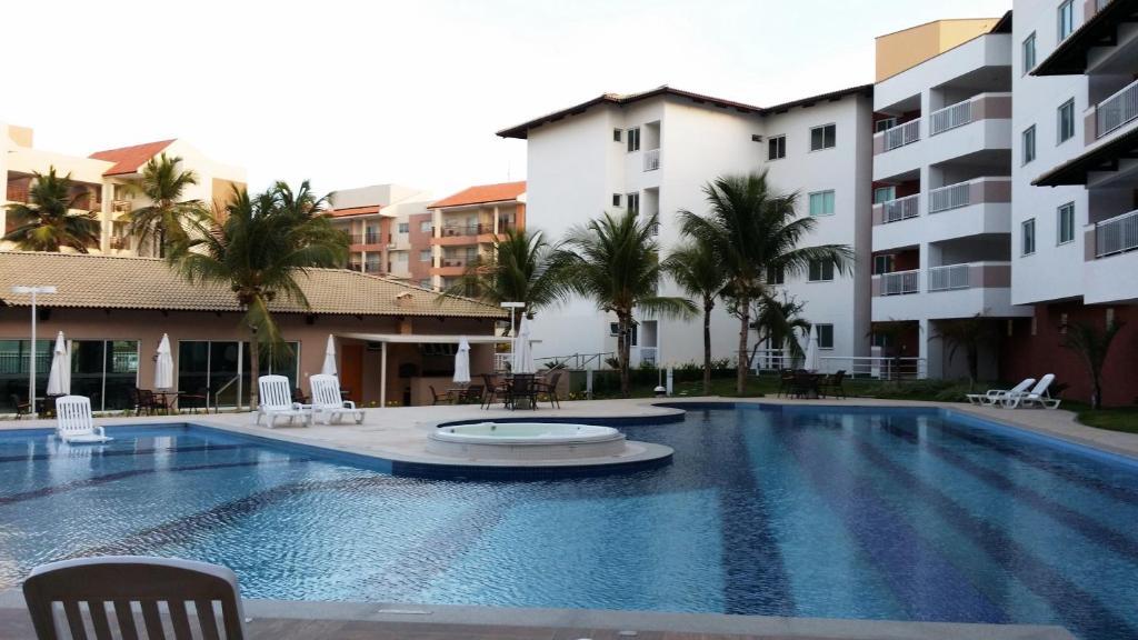The swimming pool at or near Apartamento Clube - Porto das Dunas