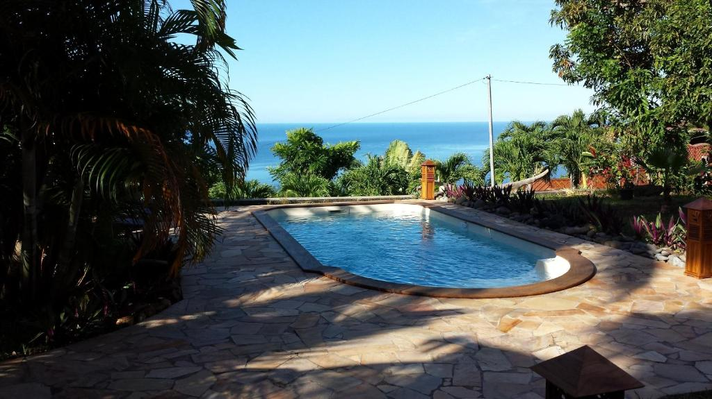 The swimming pool at or near Domaine du Piton Bellevue