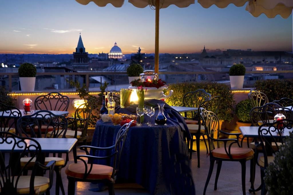 A restaurant or other place to eat at Marcella Royal Hotel